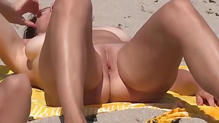 several nude girls on beach