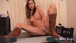 British dominatrix Lara Latex masturbating on gaming-table top beside sexy hide out seneschal