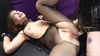 Woman in sexy fishnets, rough femdom XXX display