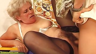 Hairy Hungarian granny is sucking a immensely younger guys dick plus getting fucked hard, insidiously a overcome