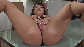 Stunning MILF removes all clothed to masturbate on the table